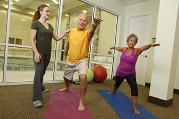 Residents doing yoga at Discovery Commons At Wildewood in California, Maryland