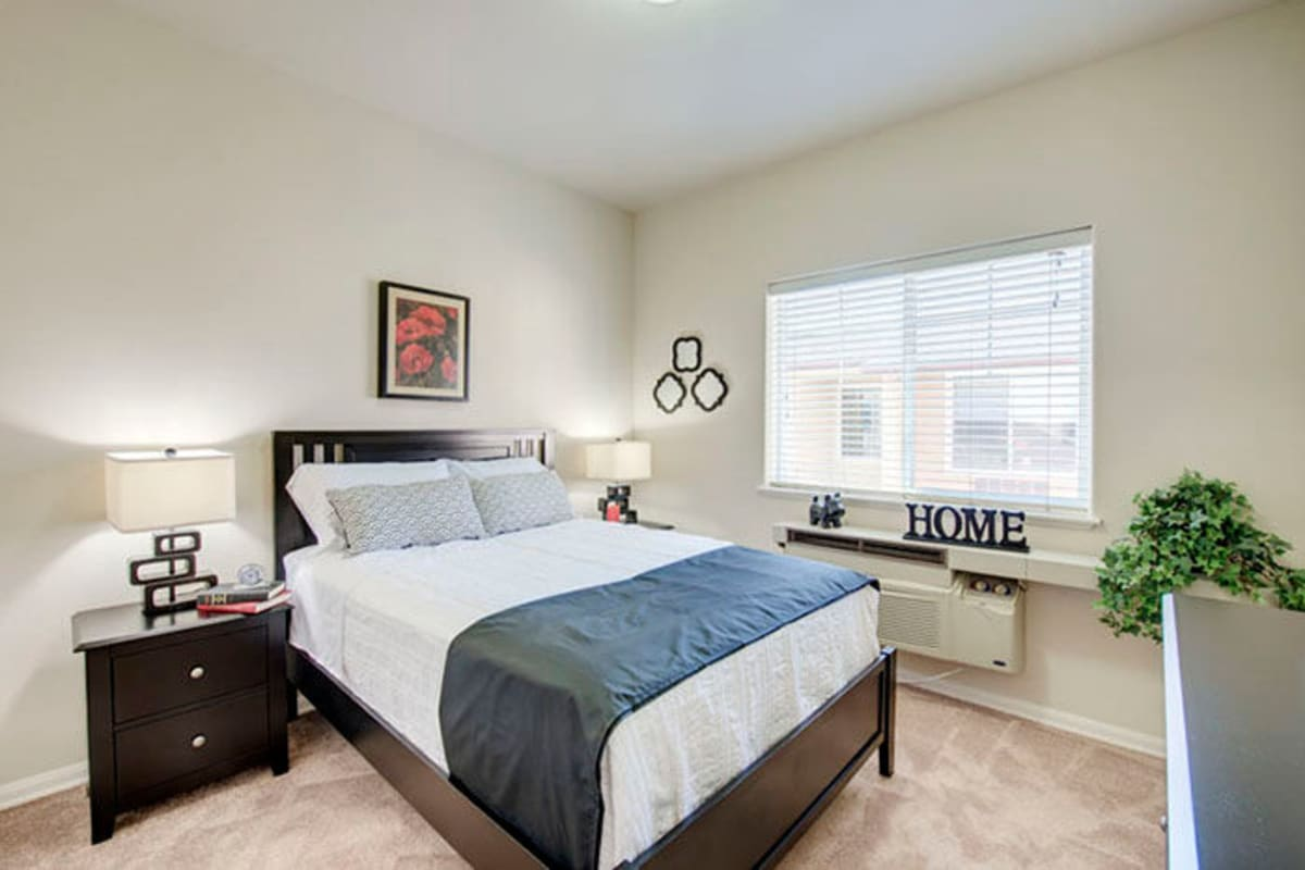 Well-lit bedroom at Cypress Place in Ventura, California
