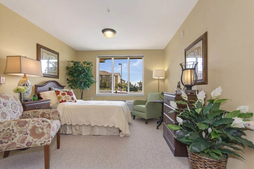 Spacious bedroom at The Pines, A Merrill Gardens Community in Rocklin, California.