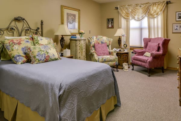 Assisted living apartment bedroom at Carrington Place in Pittsburg, Kansas