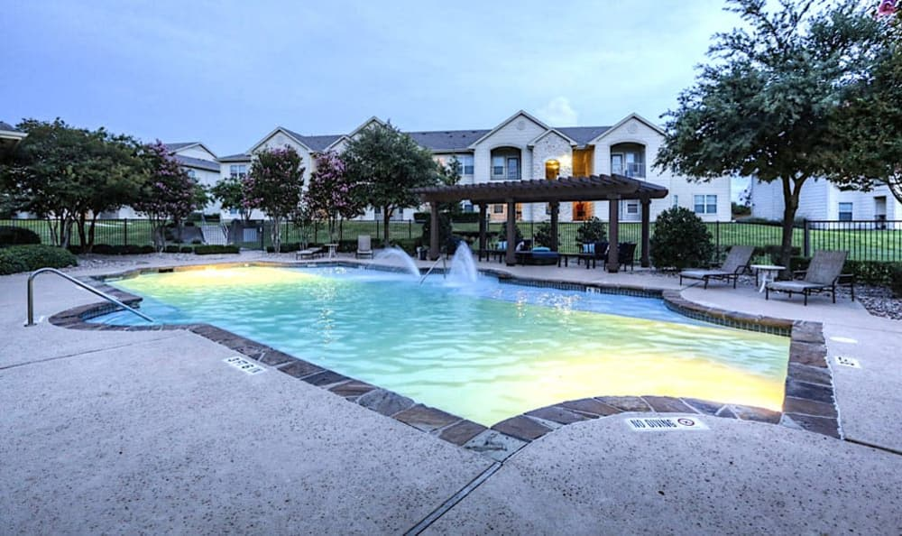 Sunset pool view at Stone Creek Apartments