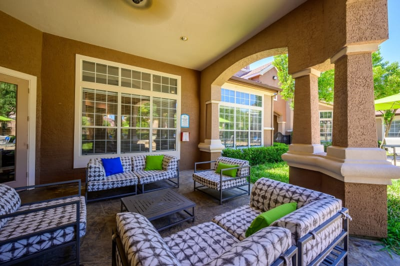 Clubhouse lounge chairs and couches poolside at The View at Lakeside in Lewisville, Texas