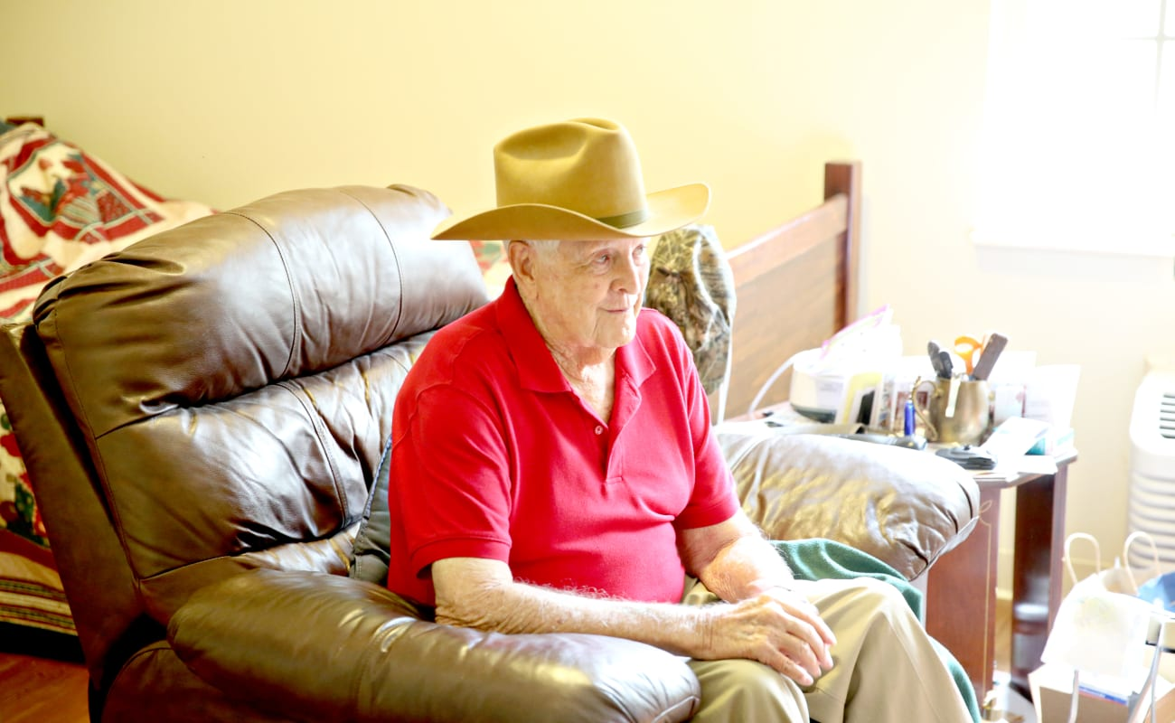 A male resident relaxing, sitting on his chair at Providence Assisted Living in Searcy, Arkansas