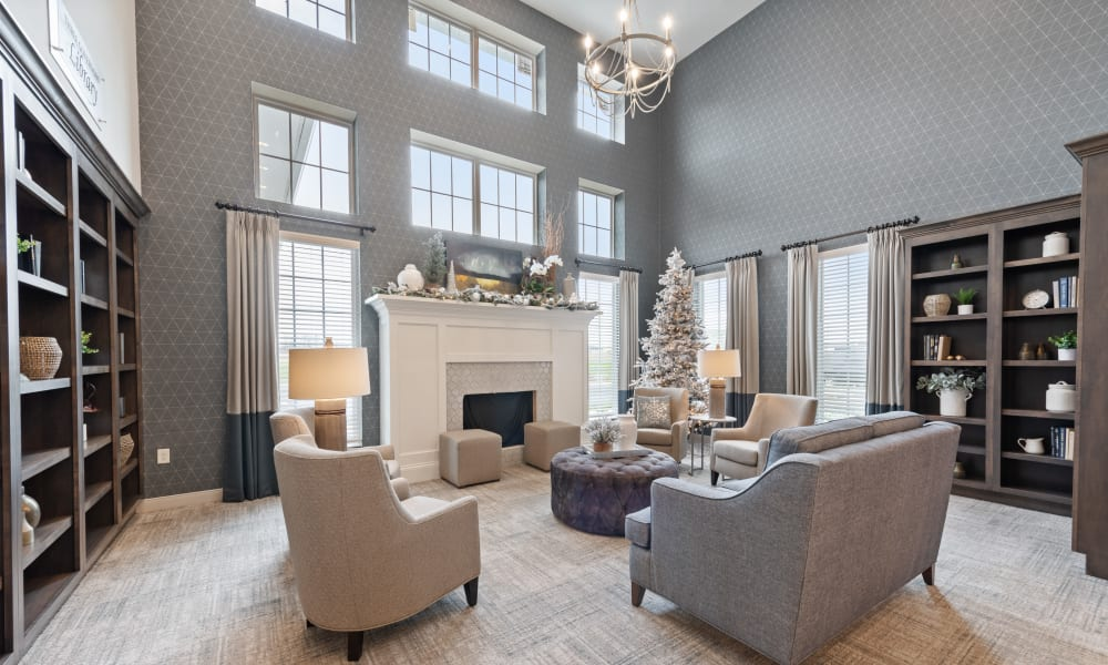 Beautifully decorated resident clubhouse with a fireplace at Trilogy Health Services - Owensboro in Owensboro, Kentucky