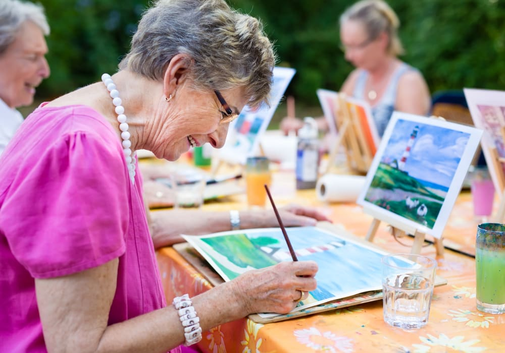 Senior Woman painting at The Village of the Heights in Houston, Texas