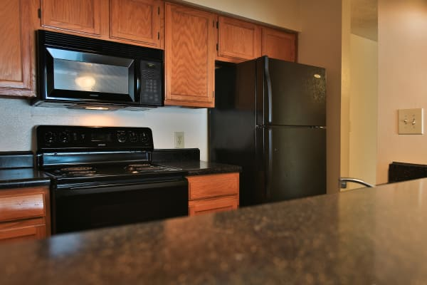 Kitchen in apartment at Turtle Creek Vista Apartments in San Antonio, Texas