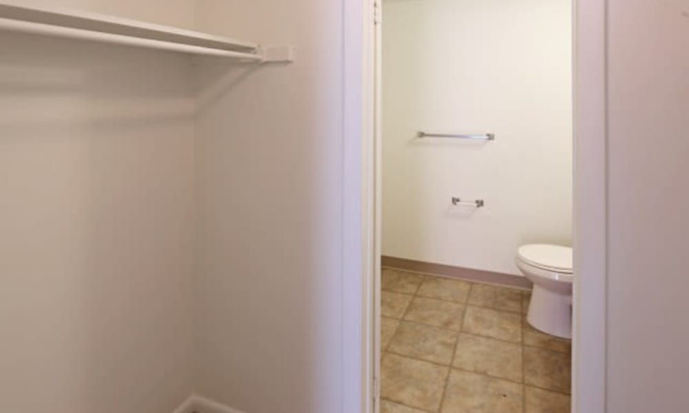 Closet and bathroom at Westminster Place Apartments in Liverpool, NY
