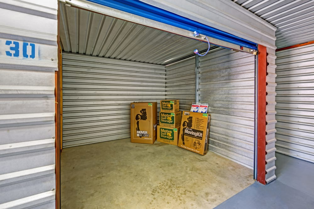 Open unit with packages at Metro Self Storage in Euless, Texas
