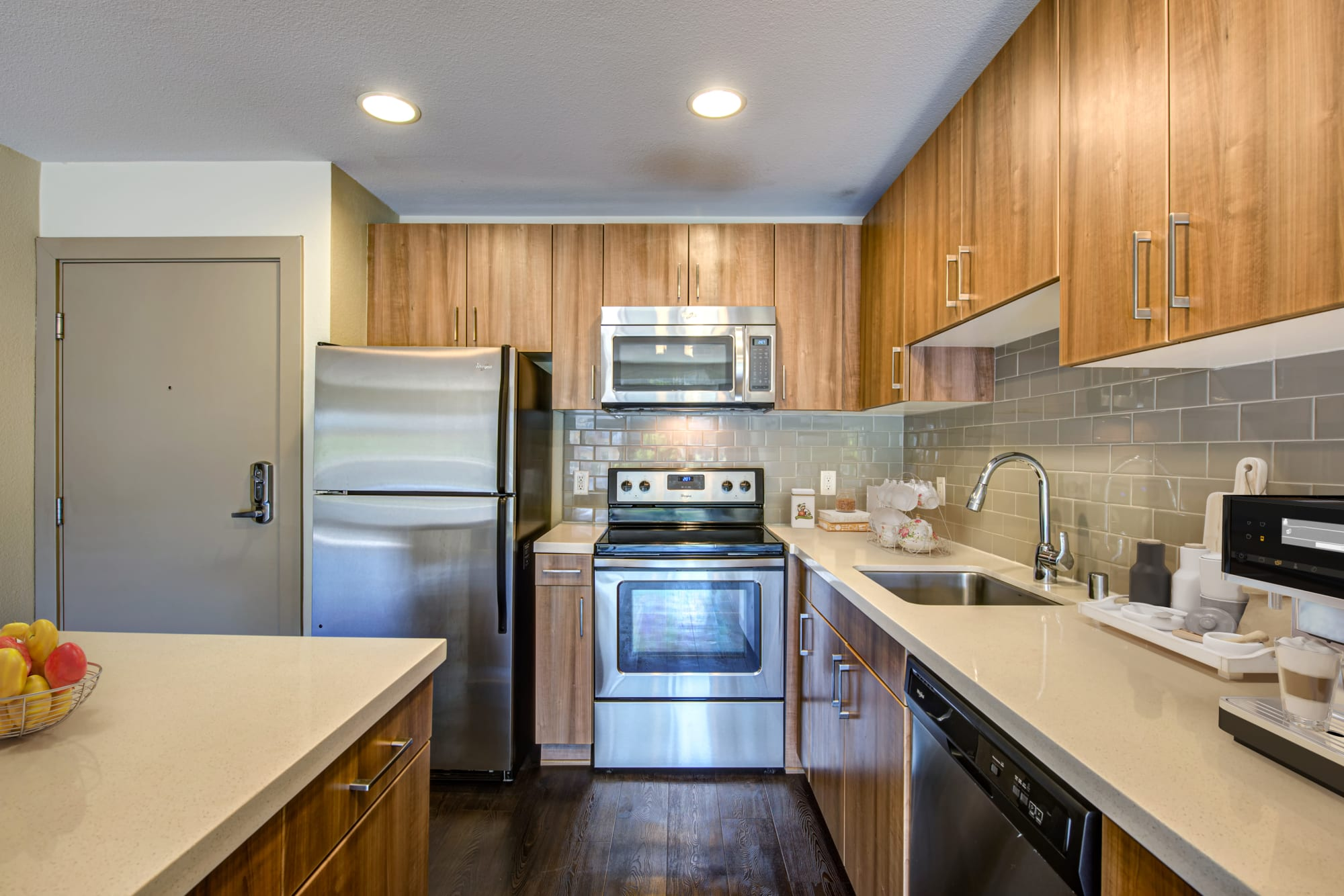 Modern kitchen with quartz countertops at Harborside Marina Bay Apartments in Marina del Rey, California