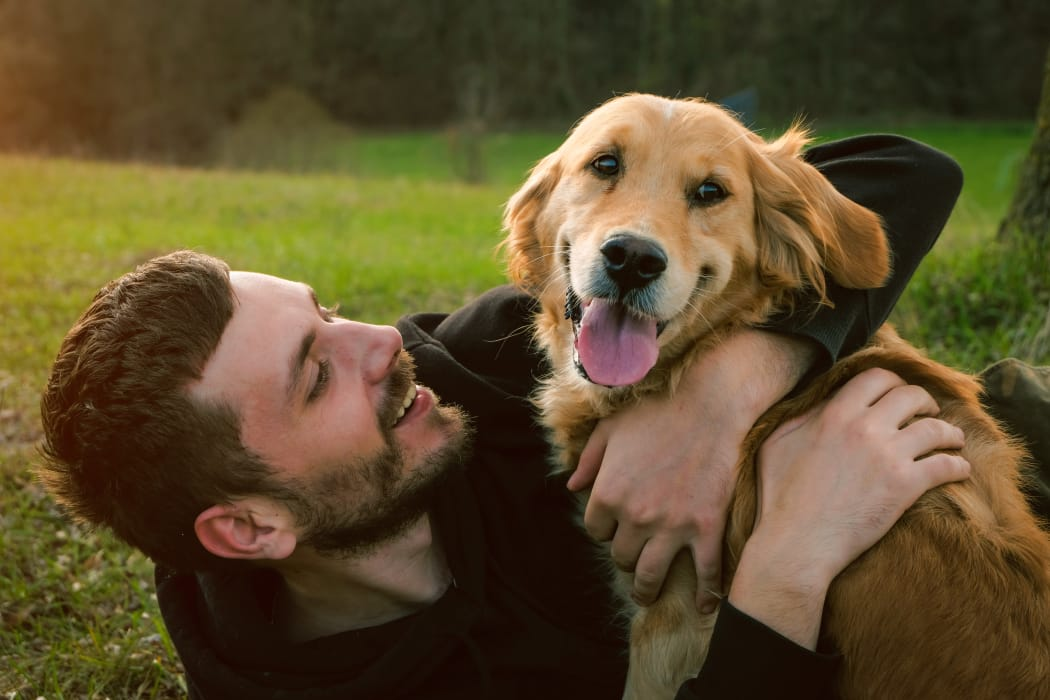 Man hugging his lovely dog at Crescent Oaks in Graham, North Carolina