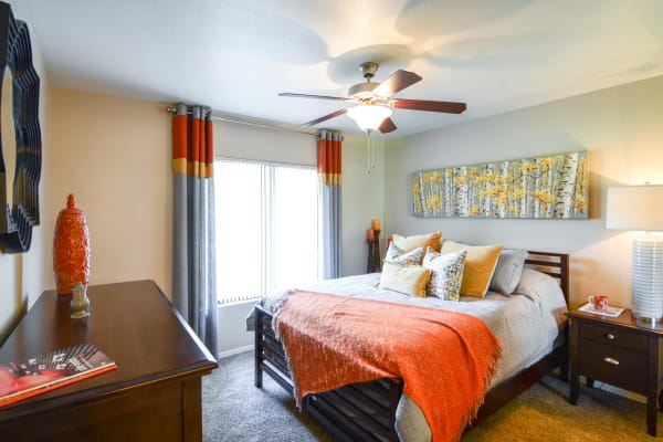 Large bedroom with orange accents at The Palms on Scottsdale in Tempe, Arizona