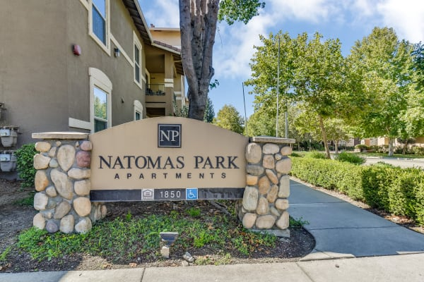 Apartment building sign in front of Natomas Park Apartments in Sacramento, California