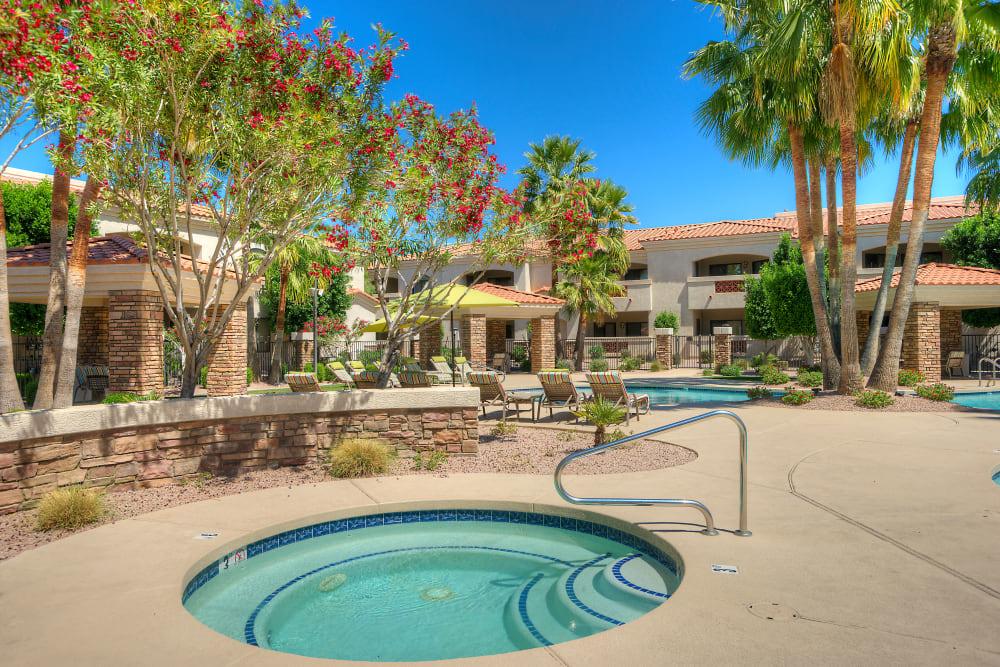 Luxurious hot tub near the pool at San Prado in Glendale, Arizona
