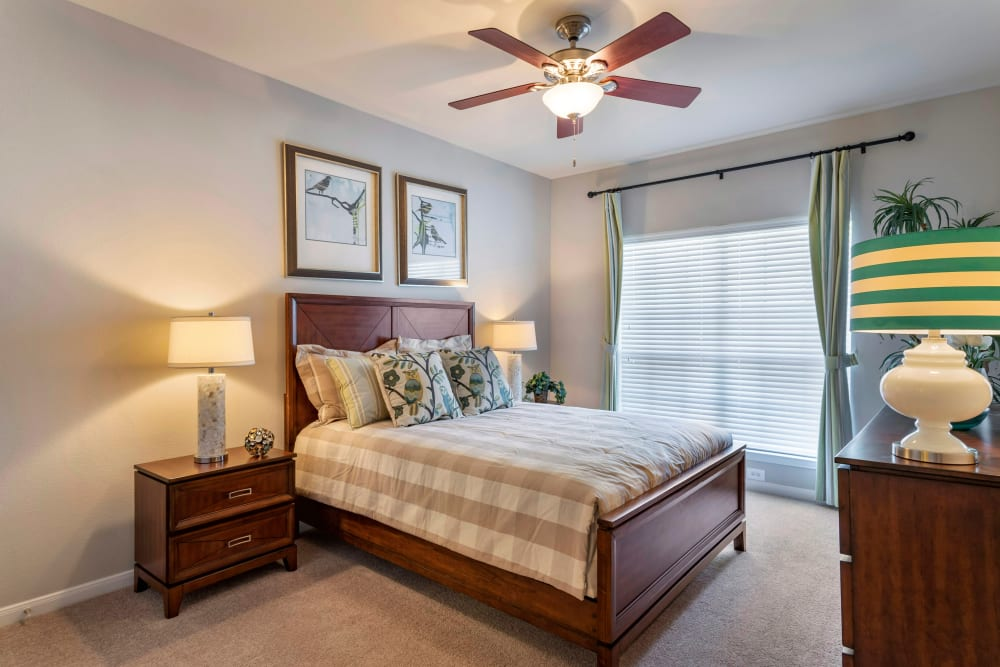 Spacious model bedroom with a ceiling fan at Regency at First Colony in Sugar Land, Texas