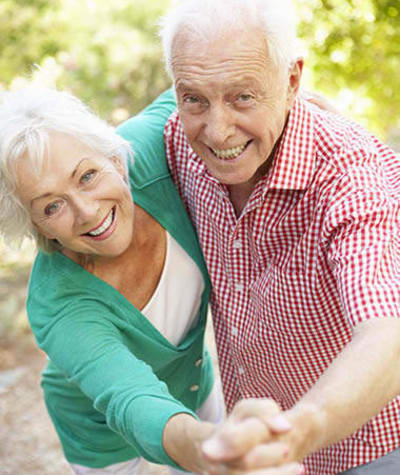 Resident couple at Mattison Crossing at Manalapan Avenue dancing together in Freehold, New Jersey.