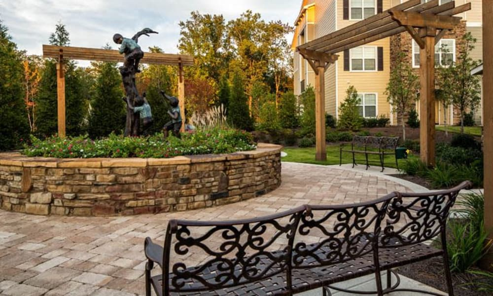 Courtyard with a statue at Enclave at Highland Ridge in Columbus, Georgia