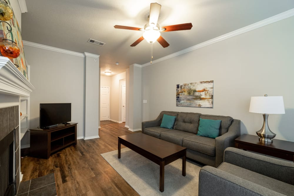 Bright living room with fireplace at Marquis at Bellaire Ranch in Fort Worth, Texas
