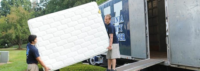 Employees loading heavy belongings into a moving truck in Salem, Virginia