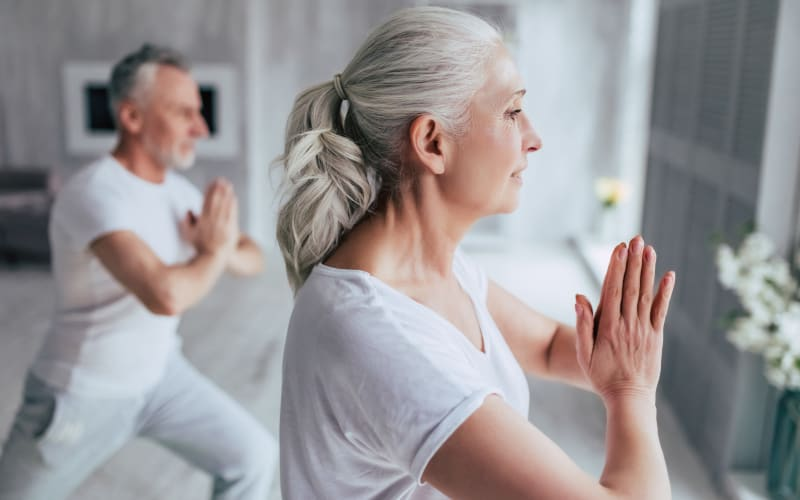 Residents meditating at a Anthology Senior Living community