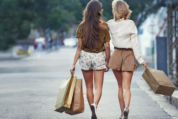 Girls walking on the street near Citation Club in Farmington Hills, Michigan