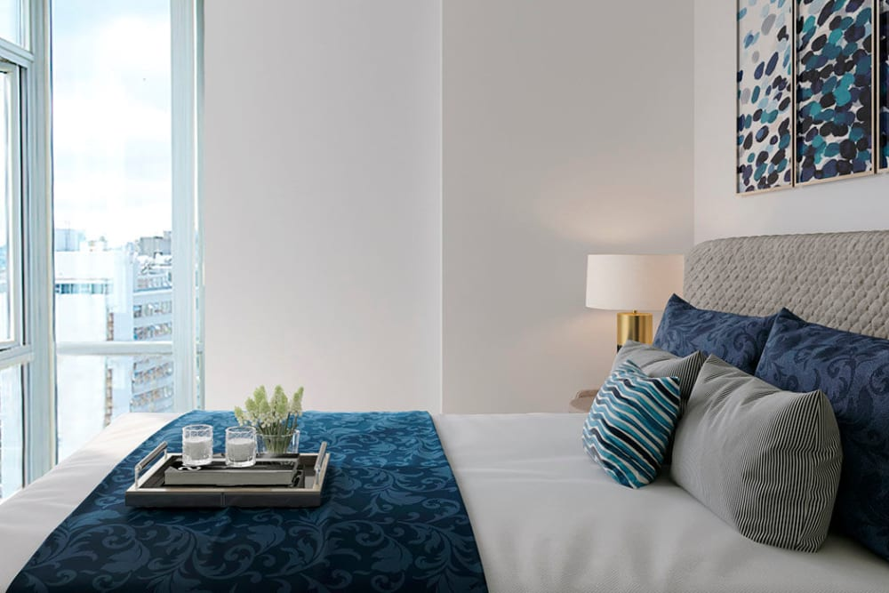 Enjoy apartments with a modern bedroom at Bayview at Coal Harbour in Vancouver, British Columbia