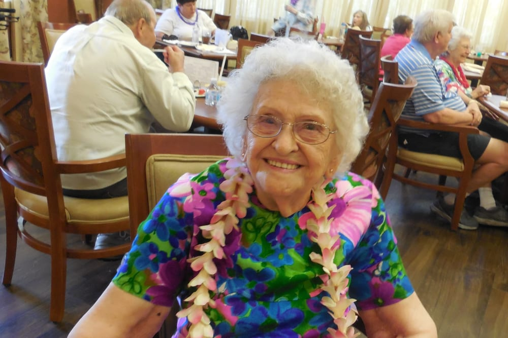 A resident at a luau at The Groves, A Merrill Gardens Community in Goodyear, Arizona.