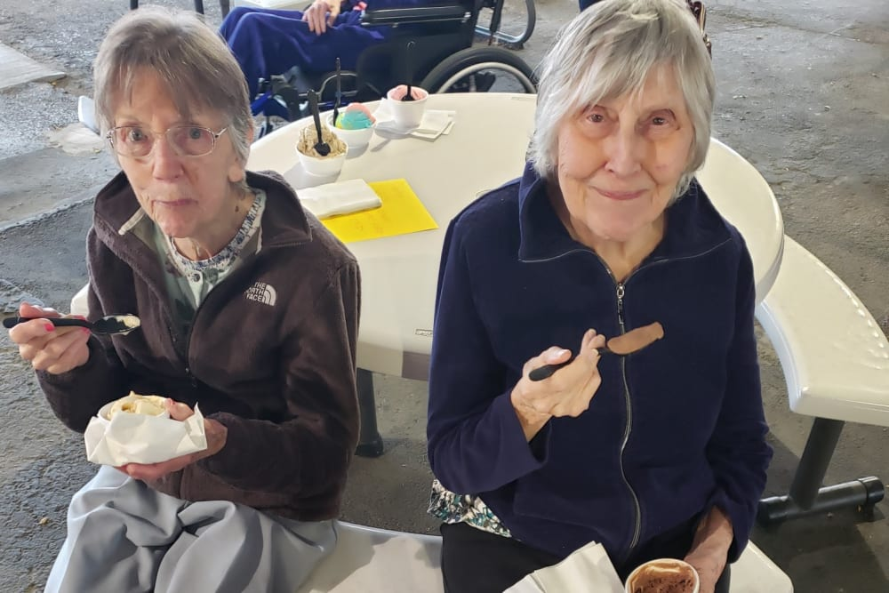 Residents happily enjoying a snack at Brooklyn Pointe in Brooklyn, Ohio