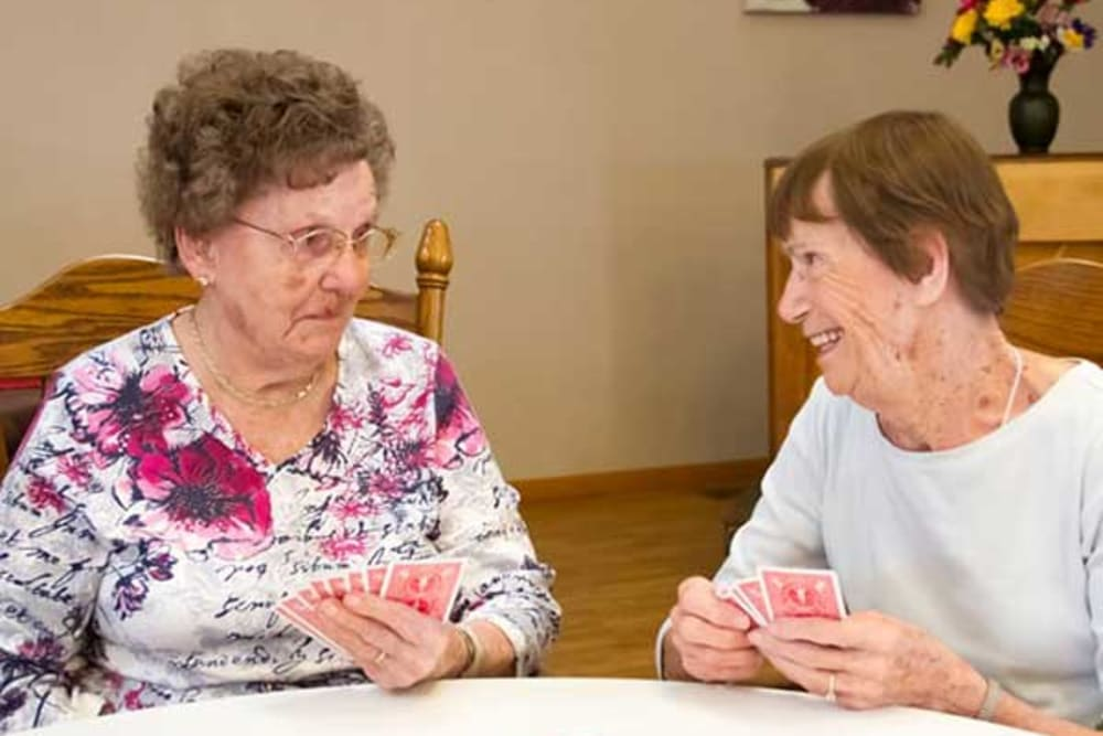 Residents playing cards at Garden Place Red Bud in Red Bud, Illinois.