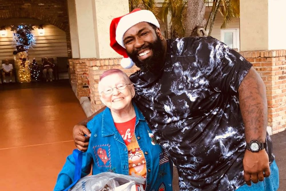 A happy resident with a visitor at Bayside Terrace in Pinellas Park, Florida