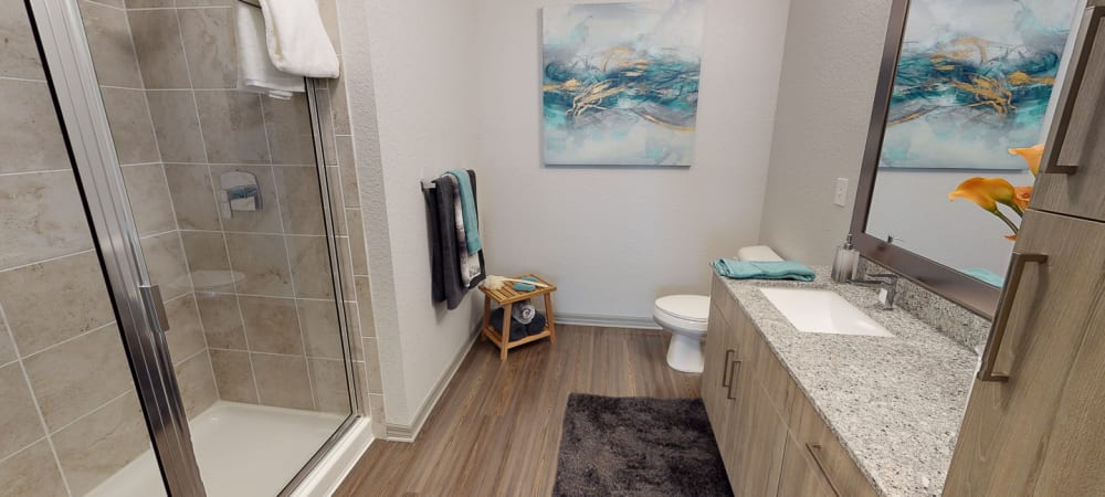 Spacious bathroom with large mirror and ample counter space at Integra 289 Exchange in DeBary, Florida