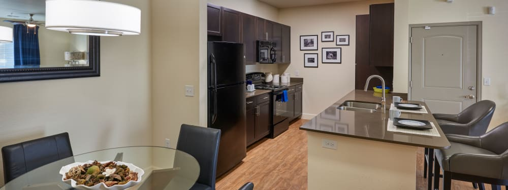 An open kitchen and dining room at M2 Apartments in Denver, Colorado