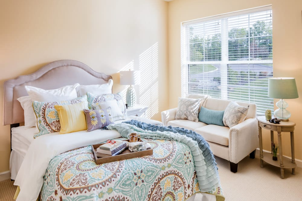 Resident bedroom with large windows at Anthology of Overland Park in Overland Park, Kansas