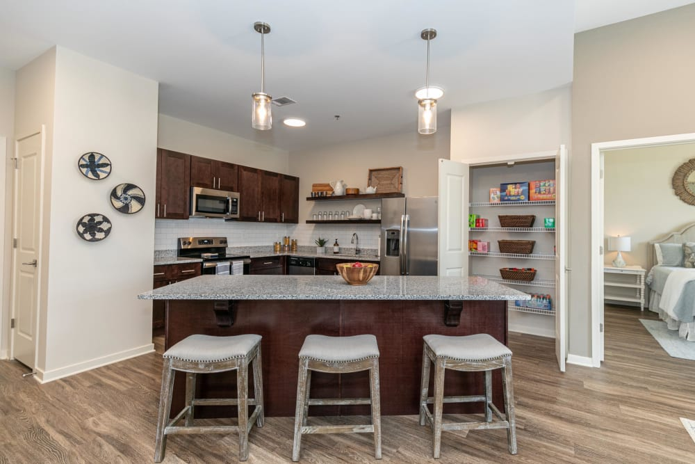 Gorgeous gourmet kitchen with an island and granite countertops in a model home at The Station at River Crossing in Macon, Georgia