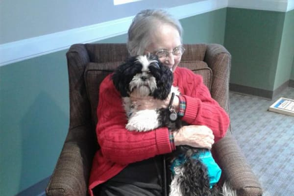 A resident hugs her dog at First & Main of Lewis Center in Lewis Center, Ohio