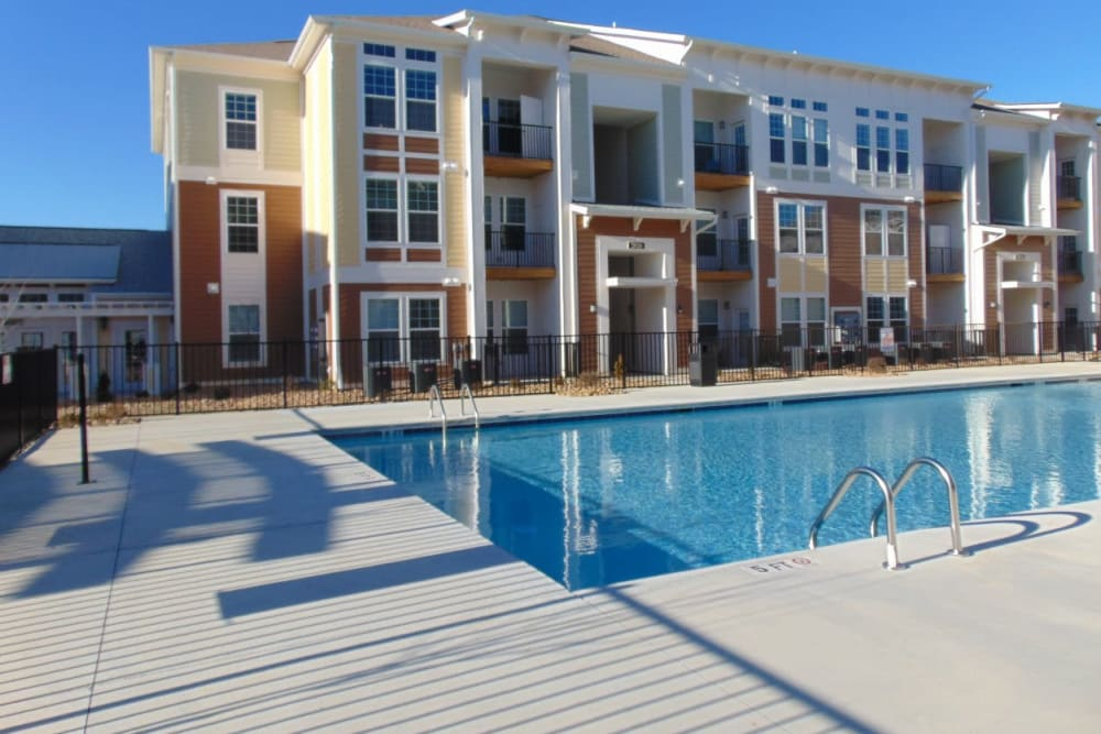 Beautiful swimming pool at Watercourse Apartments in Graham, North Carolina
