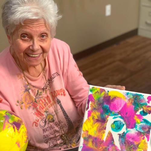 A happy resident with a painting project at FountainBrook in Midwest City, Oklahoma