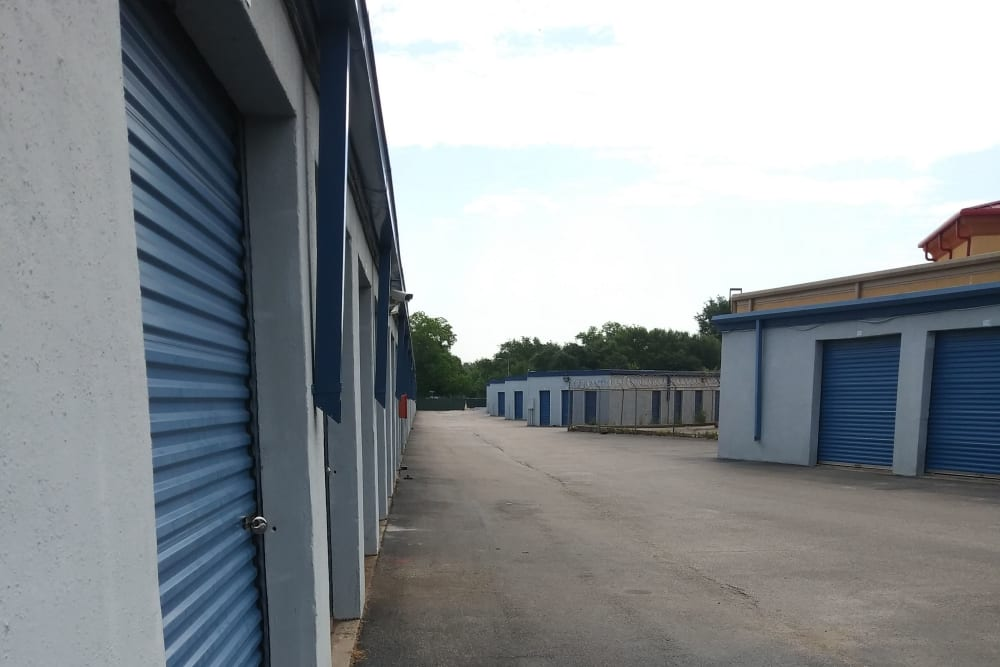 A row of outdoor storage units at Store It All Self Storage - Airline in Houston, Texas