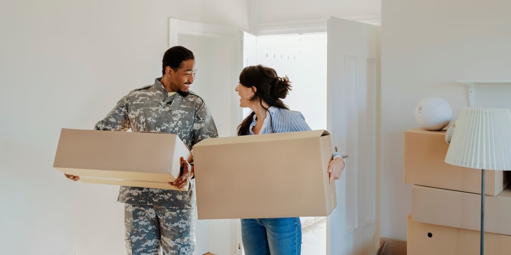 A young military couple moves into their new apartment near A-1 Self Storage