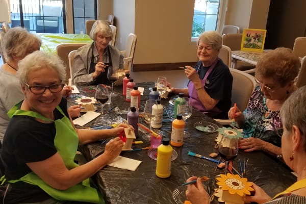 Residents making crafts at Merrill Gardens at Rancho Cucamonga in Rancho Cucamonga, California.