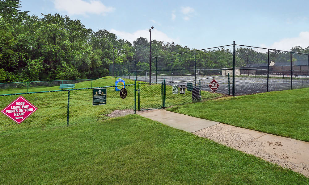 Dog park next to a tennis court at Sherwood Crossing Apartments & Townhomes in Philadelphia, Pennsylvania
