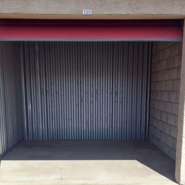 An open outdoor storage unit at StorQuest Self Storage in Phoenix, Arizona