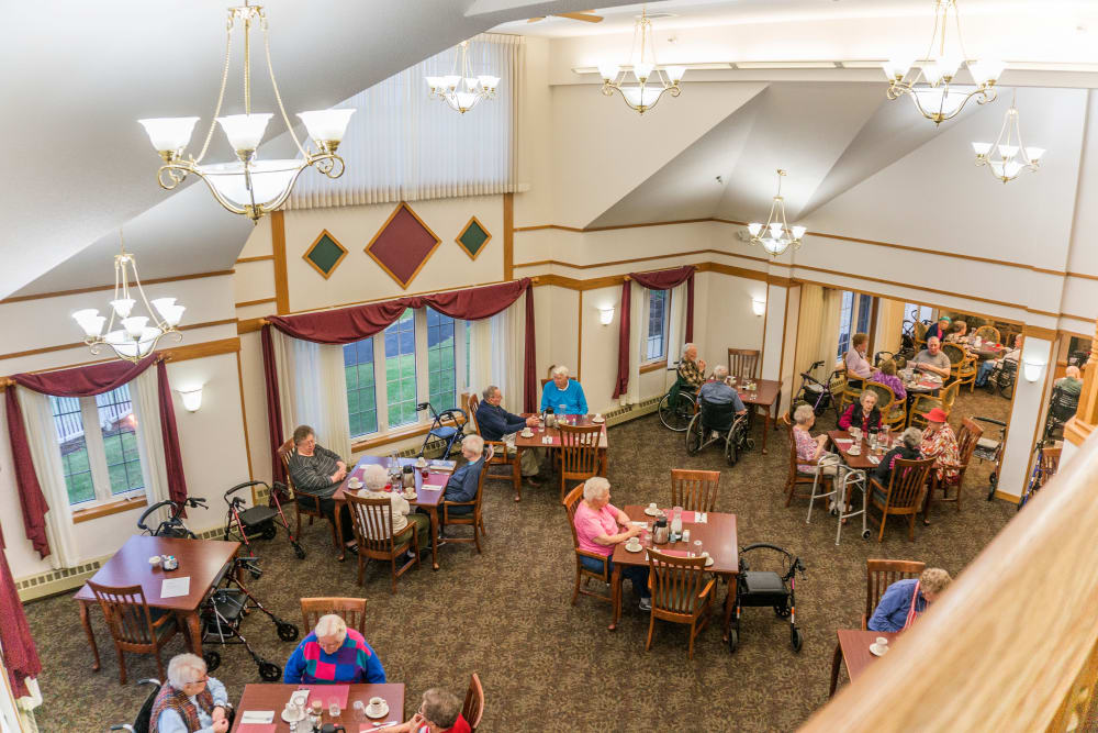Resident dining room seen from balcony at Meadow Lakes Senior Living in Rochester, Minnesota.