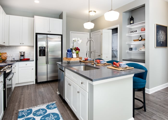 Spacious apartment kitchen layouts at Avenida Cool Springs senior living apartments in Franklin, Tennessee