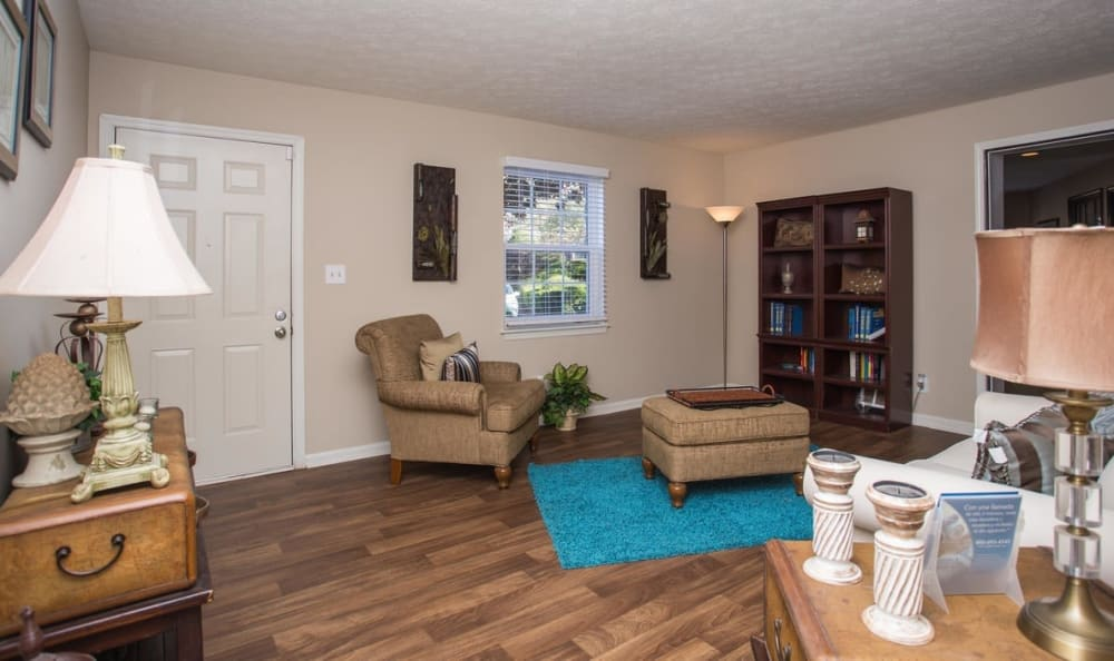 Open-concept living area with hardwood floors in a model home at The Arbors at Smyrna in Smyrna, Georgia