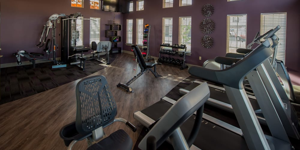 Well equipped fitness center at Watercress Apartments in Maize, Kansas