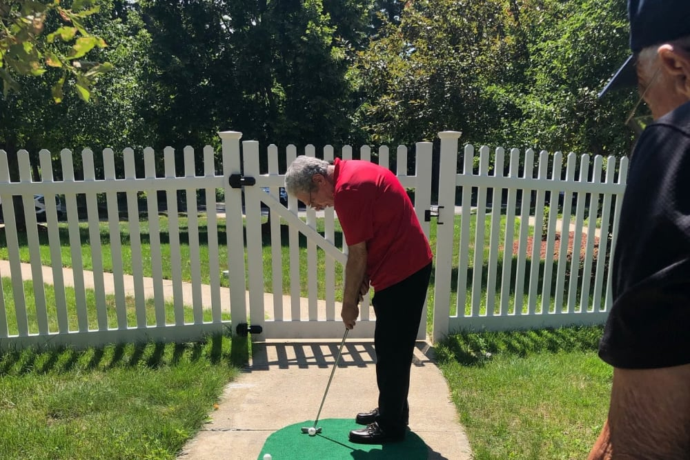 Residents playing mini golf at Wood Haven in Tewksbury, Massachusetts