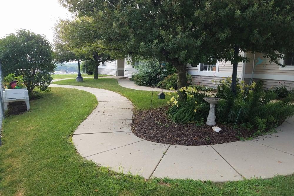 Winding walking path with bench at Clover Ridge Place in Maquoketa, Iowa.