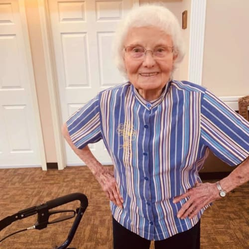 A resident free-standing next to her walker at Canoe Brook Assisted Living in Broken Arrow, Oklahoma