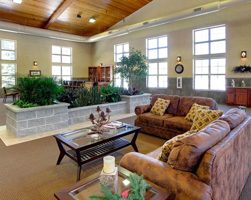 Spacious, bright common room with vaulted ceilings at Milestone Senior Living in Eagle River, Wisconsin.