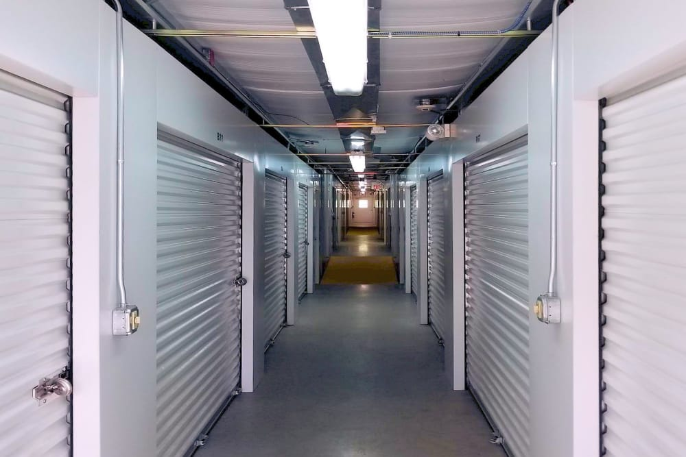 Hallway of indoor storage units at Prime Storage in North Grafton, Massachusetts